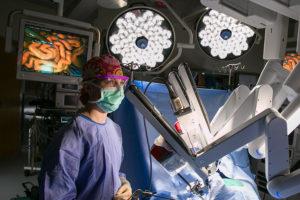 Doctor standing near medical equipment